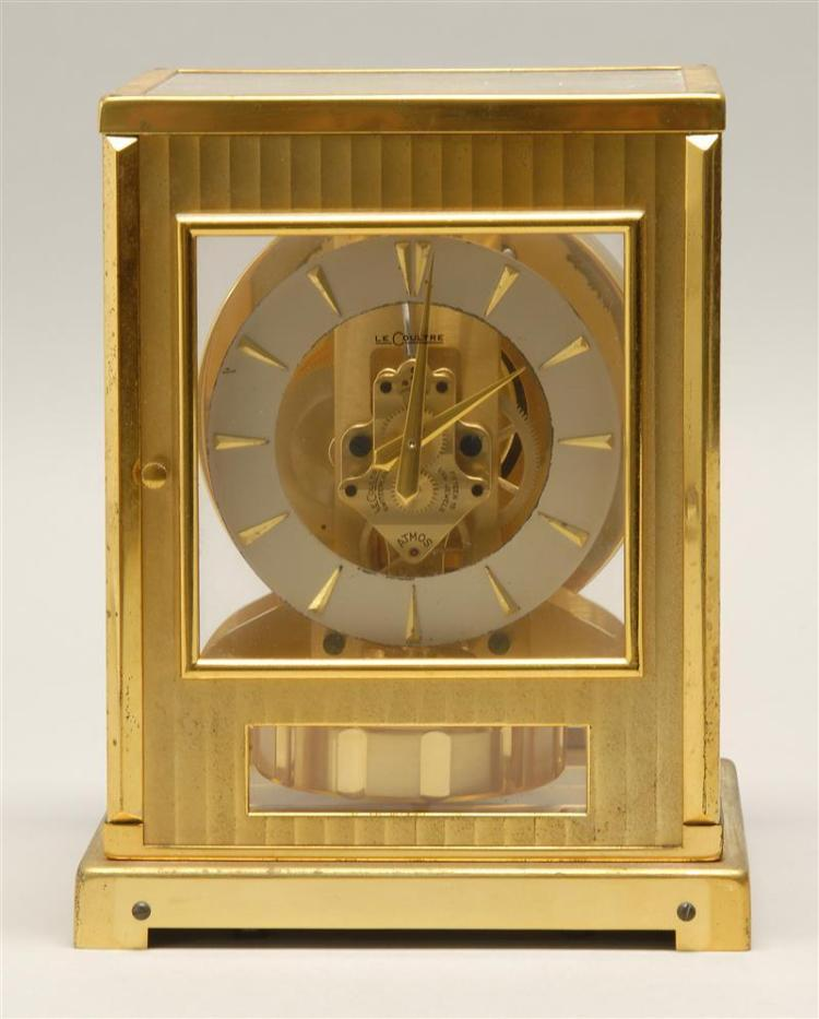 """ATMOS CLOCK BY LECOULTRE In brass case with perpetual motion pendulum. Height 9""""."""