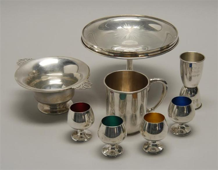 NINE STERLING SILVER ITEMS By various makers. Sterling silver holloware includes: a Shreve & Co. pedestal candy dish, Dominick & Haf...