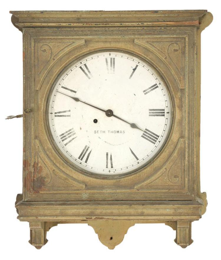 """SETH THOMAS WALL CLOCK In an Eastlake-style case in beige paint. Diameter of dial 12.25"""". Length overall 23"""". Some damage to molding."""