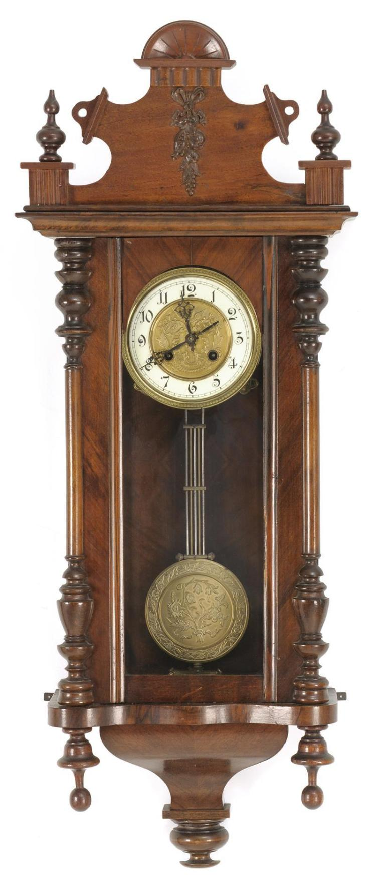 VIENNA-STYLE WALL REGULATOR CLOCK In a walnut-veneered case. Circular brass face with winged angel at top. Black numerals on ivory-c...