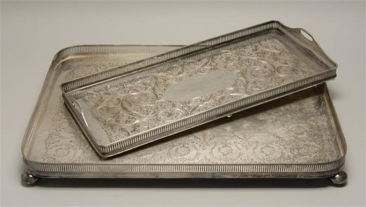 """TWO SILVER PLATED GALLERIED SERVING TRAYS Largest one is by Barnby & Rust of Hull with floral decoration on bun feet, 16"""" x 24"""". The..."""