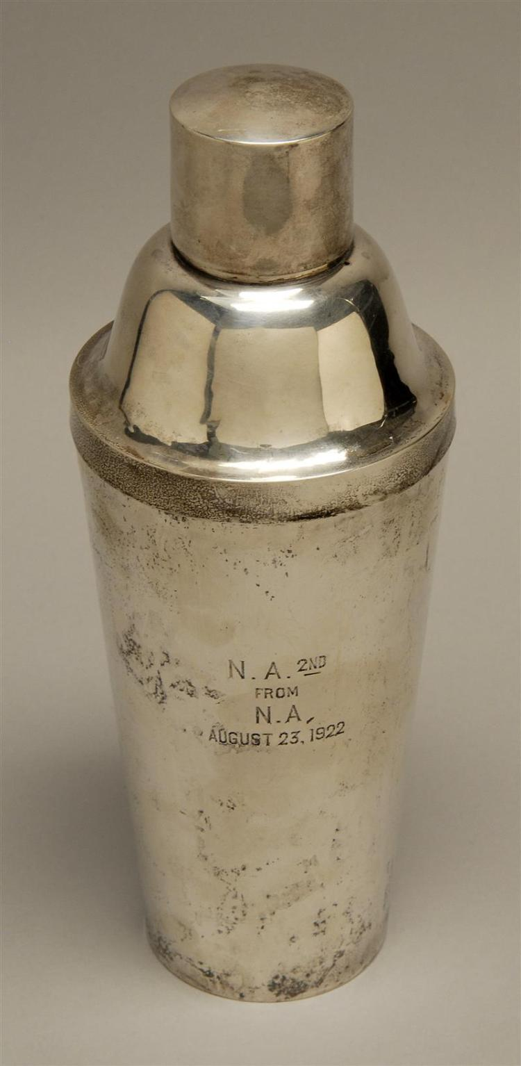 """RICHARD DIMES PROHIBITION-ERA STERLING SILVER COCKTAIL SHAKER Of typical form, with presentation inscription. Height 10.25"""". Approx...."""