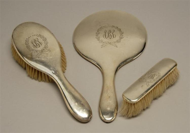 """GORHAM STERLING SILVER THREE-PIECE DRESSING SET Includes a hand mirror, hairbrush, and clothes brush. Length of mirror 10.75""""."""