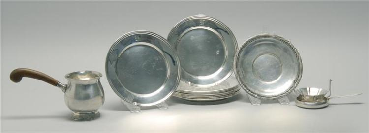 TEN PIECES OF AMERICAN AND SOUTH AMERICAN STERLING SILVER HOLLOWWARE 1) Eight monogrammed bread and butter plates. Unmarked. Diamete...