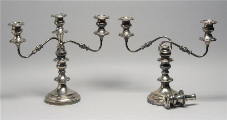 PAIR OF ENGLISH SILVER MFG. CORP. GEORGIAN-STYLE SILVER PLATED THREE-LIGHT CONVERTIBLE CANDELABRA Each with two scrolling arms and g...