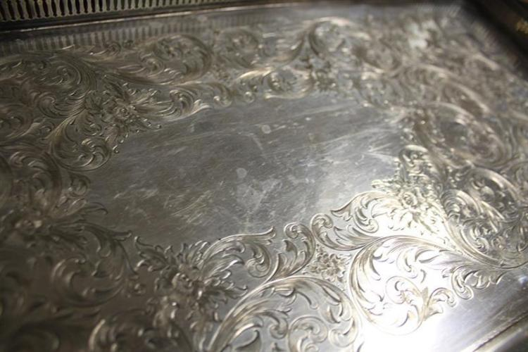 TWO SILVER PLATED GALLERIED SERVING TRAYS Largest one is by Barnby & Rust of Hull with floral decoration on bun feet, 16