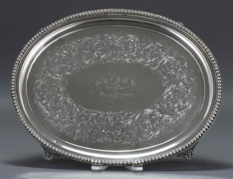 """JONES, BALL & CO. COIN SILVER PRESENTATION TRAY Oval tray with beaded rim and four feet. Central inscription """"G.H. to S.B.H. Oct. 29..."""