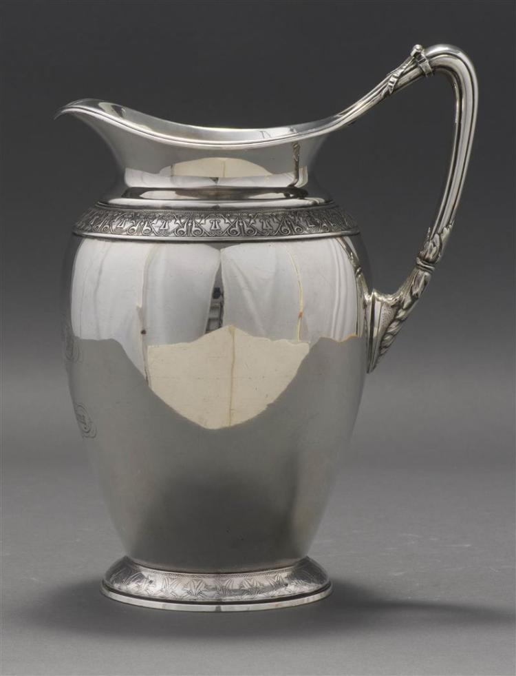 GORHAM AESTHETIC STERLING SILVER PITCHER Baluster-form pitcher with die-rolled registers of stylized ornament along shoulder and foo...