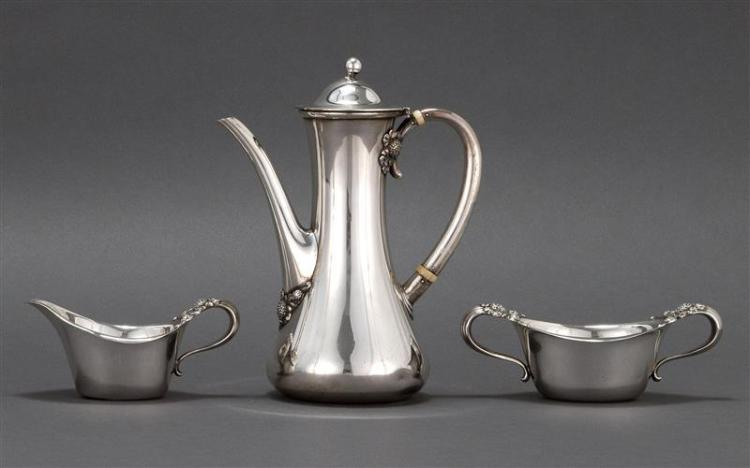 "TIFFANY & CO. THREE-PIECE STERLING SILVER ""CLOVER"" PATTERN COFFEE SERVICE Includes a coffeepot, height 8.25"", a creamer and an open..."