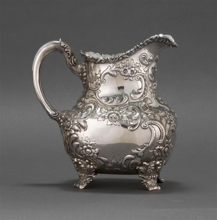 FUCHS & BEIDERHASE STERLING SILVER WATER PITCHER Retailed by Black, Starr & Frost. Decorated with repoussé flowers and C-scrolls. Fo...