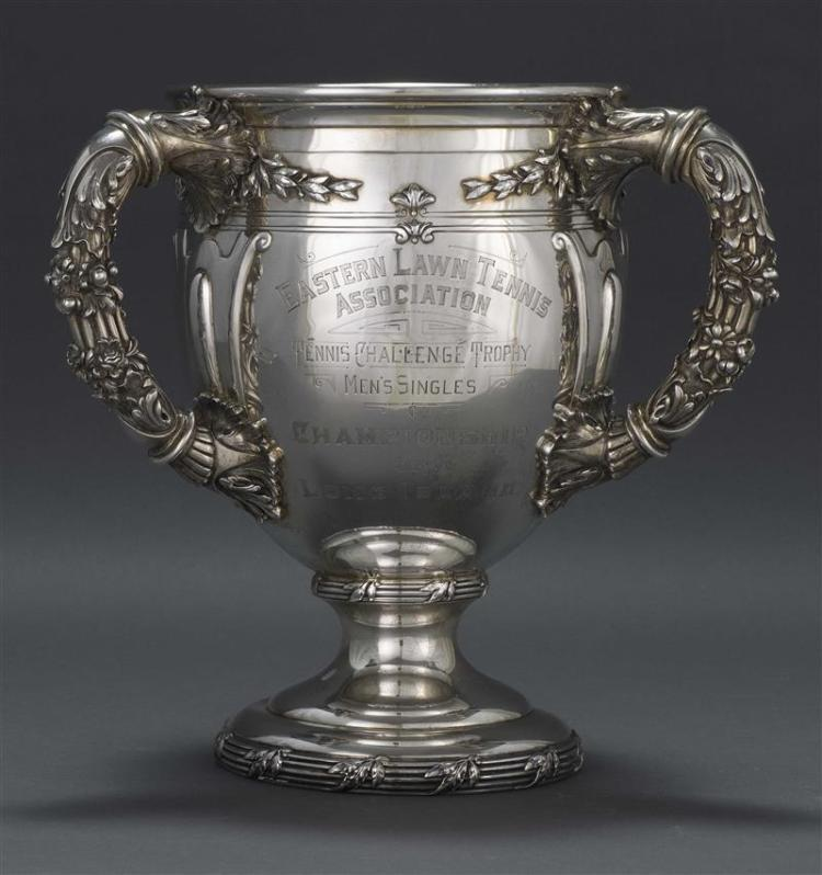 THEODORE B. STARR STERLING SILVER LOVING CUP TENNIS TROPHY In urn form with three handles elaborately decorated with acanthus leaves...