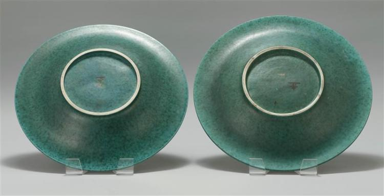 PAIR OF GUSTAVSBERG ARGENTA CERAMIC CHARGERS Designed by Wilhelm Kåge (Swedish, 1889-1960). In mottled aqua glaze with silver overla...