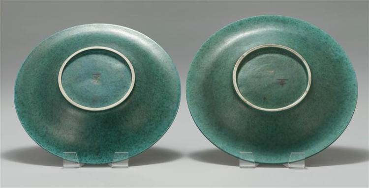 PAIR OF GUSTAVSBERG ARGENTA CERAMIC CHARGERS Designed by Wilhelm Kåge (Swedish, 1889-1960). In mottled aqua glaze with silver overla...