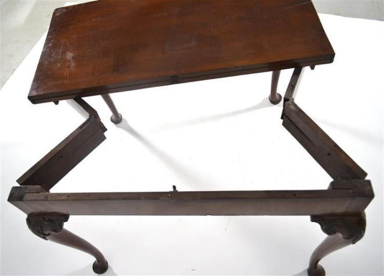 ANTIQUE ENGLISH GEORGE II ACCORDION CARD TABLE In mahogany. When open, the hinged top is supported by legs that expand via an accord...