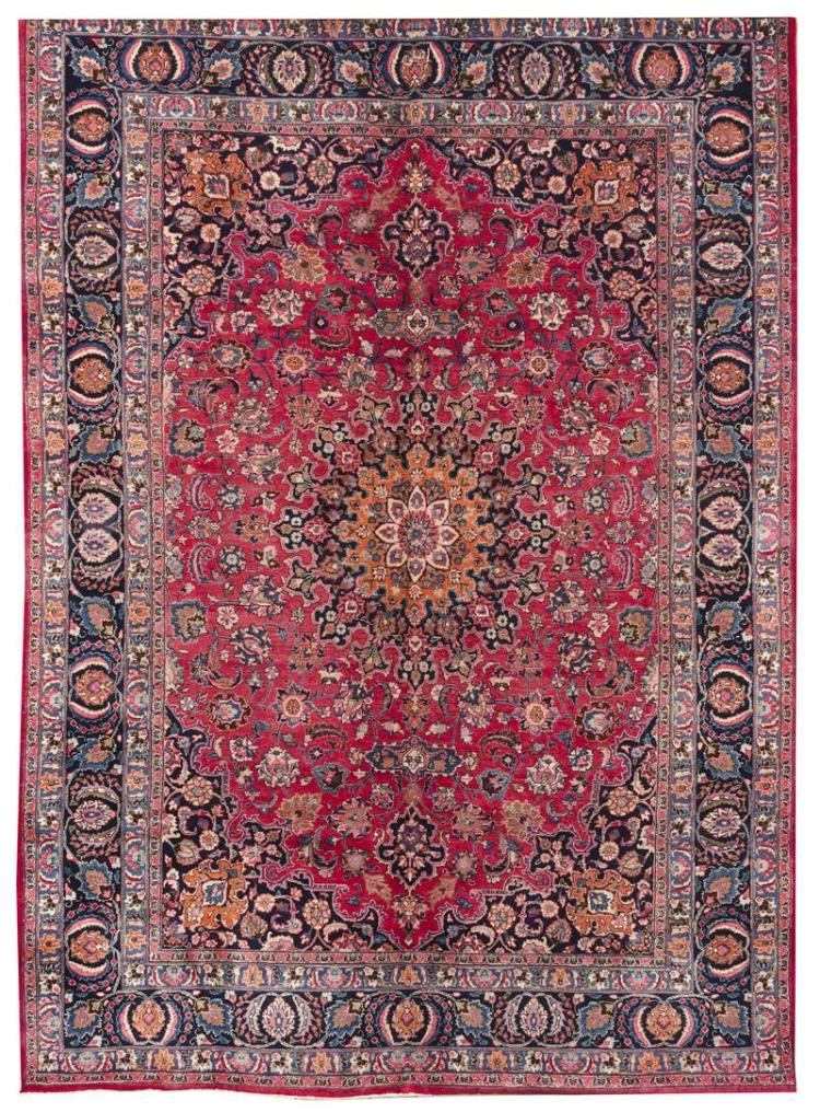 """ORIENTAL RUG: MESHED 8''4"""" x 11''9"""" Dark berry red field with central medallion in subdued orange and navy blue. Navy blue spandrels c."""