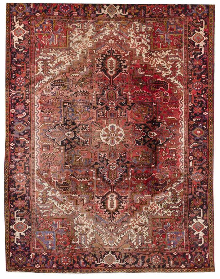"ORIENTAL RUG: HERIZ 8''5"" x 11''7"" Red field with a midnight blue and red gabled medallion and pendants. Ivory subfield and red and me."