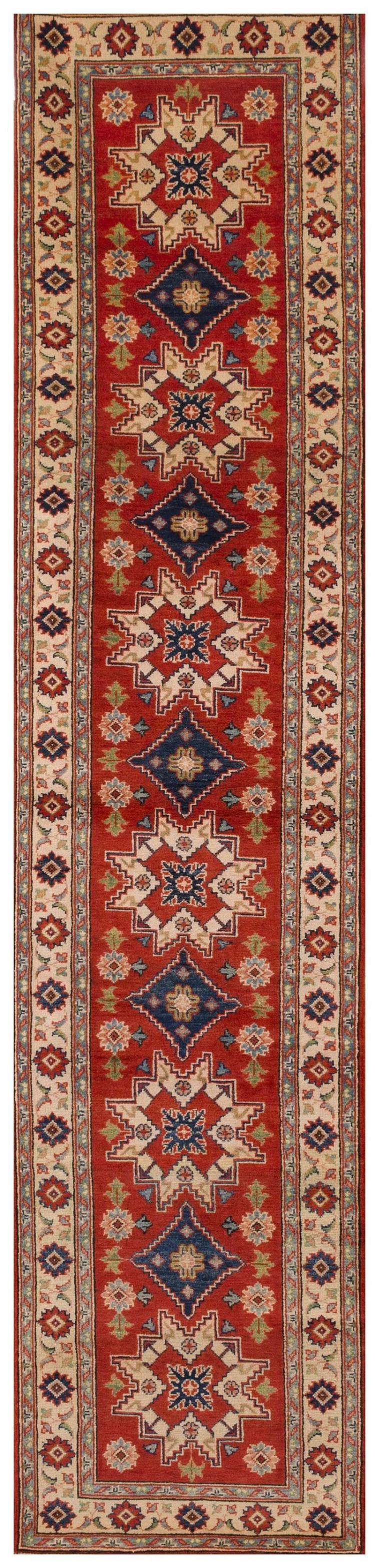 """ORIENTAL RUG: KAZAK DESIGN RUNNER 2''9"""" x 13''0"""" Red and ivory Lesghi stars alternate with a blue diamond-shaped medallion down the ce."""