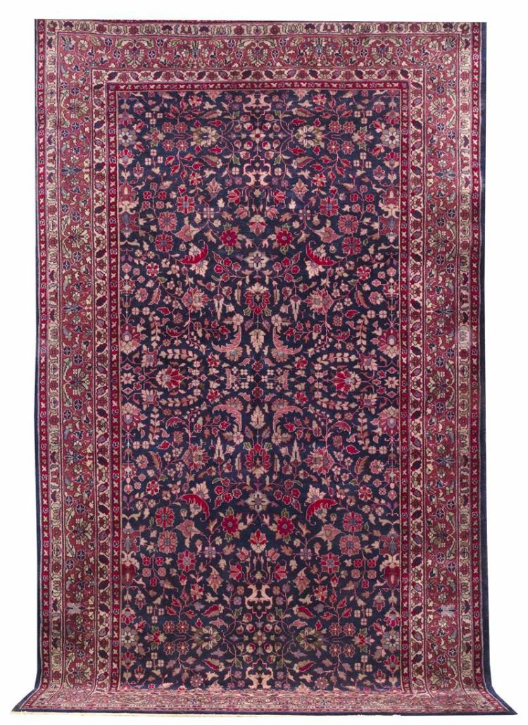 """ORIENTAL RUG: SPARTA 8''10"""" x 14''9"""" Navy blue field is covered by a symmetrical arrangement of flowering vines and branches in mauve,."""
