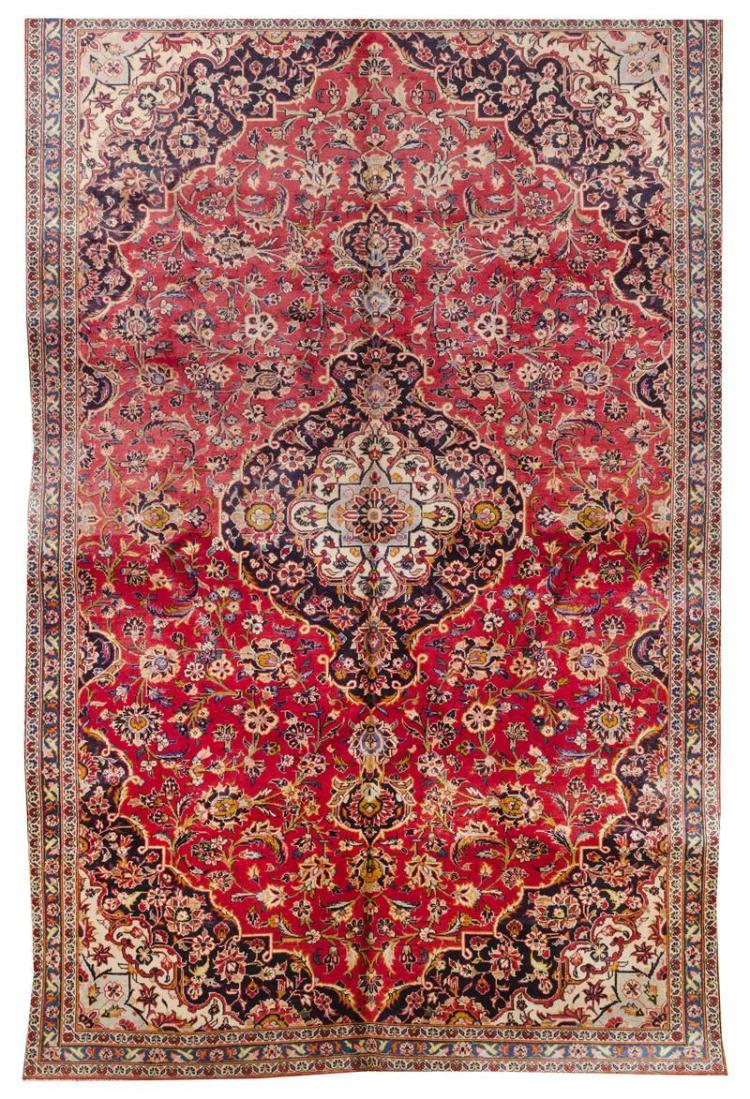 "ORIENTAL RUG: KESHAN 7''0"" x 10''6"" Abrashed red field with central navy blue medallion and pendants with light blue and ivory centers."