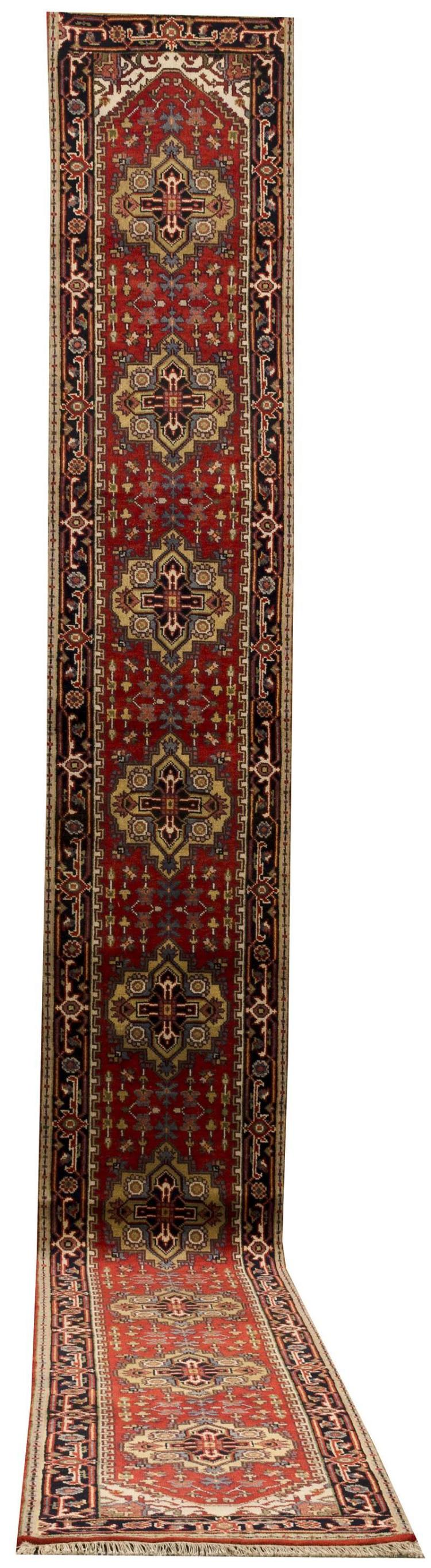 """ORIENTAL RUG: SERAPI DESIGN RUNNER 2''7"""" x 23''0"""" Series of yellow and navy blue gabled medallions cross a tomato red field and are su."""