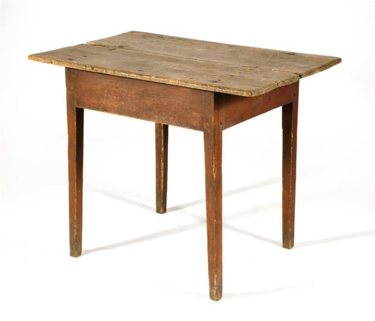 """ANTIQUE AMERICAN TAVERN TABLE In pine. Base painted red. Two-piece top and square tapered legs. Height 28.5"""". Length 41.25"""". Width 27""""."""