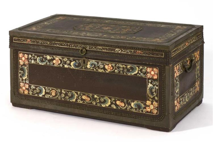 "DECORATED LEATHER-COVERED CAMPHORWOOD CHEST With flower and vine design. Brass mounts. Height 16"". Width 36"". Depth 18""."