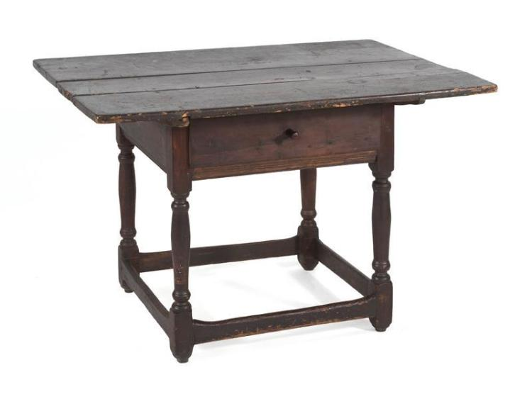 ANTIQUE AMERICAN TAVERN TABLE Probably Pennsylvania. Overhanging cleated top in walnut. Bold block and turned base with single drawe...