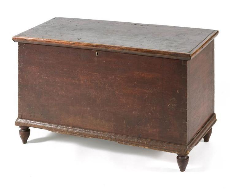 ANTIQUE AMERICAN LIFT-TOP BLANKET CHEST In pine under a dark red stain. Top attached with replacement iron hinges. Interior ditty bo...