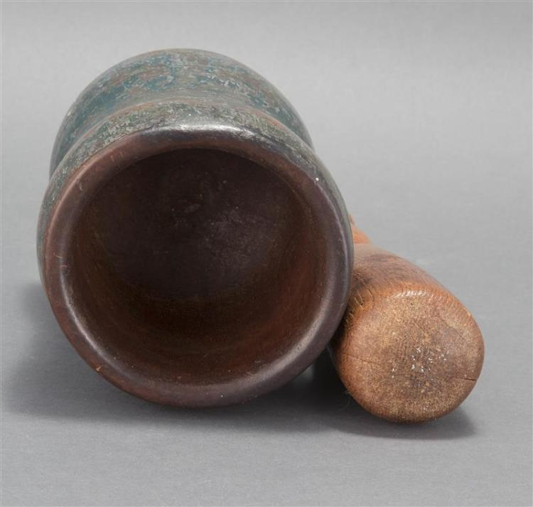 WOODEN MORTAR AND PESTLE Mortar in hardwood, probably maple, under blue-green paint. Pestle in chestnut with traces of the same pain...