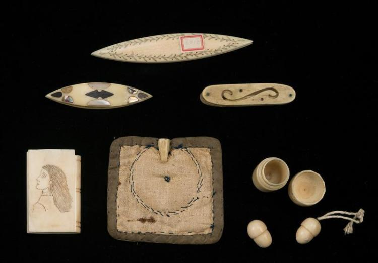 EIGHT WHALEBONE AND WHALE IVORY ITEMS Six sewing tools and two small carved acorns. Sewing tools include a needle holder, two thread...