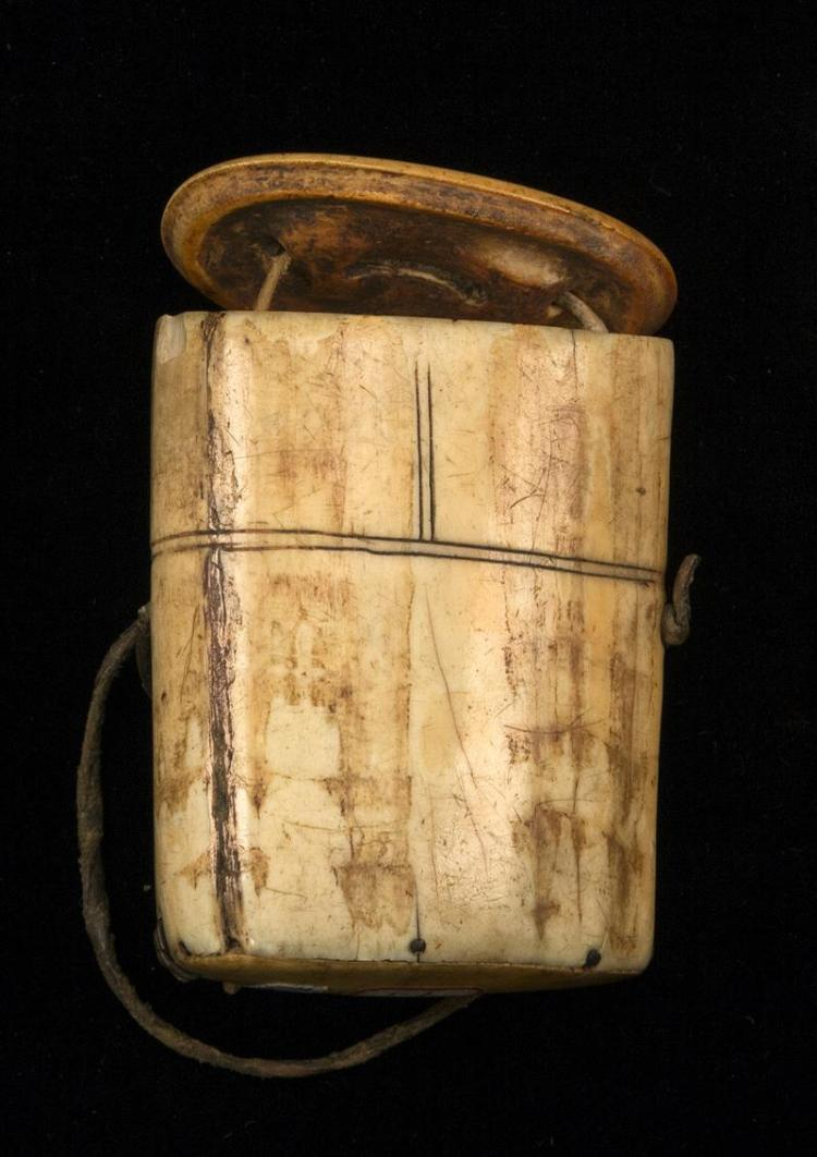 INUIT BOX CARVED FROM A WALRUS TUSK Bone top and bottom. Top with inset medium blue stone. Sides of box created from the base of a w...