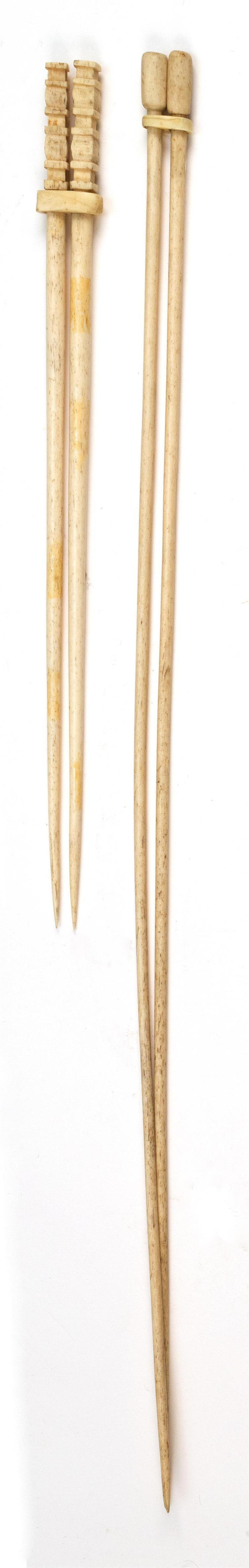 TWO PAIRS OF WHALEBONE KNITTING NEEDLES One pair with geometric carved finials. Both pairs with sliding mechanism that keeps the nee...