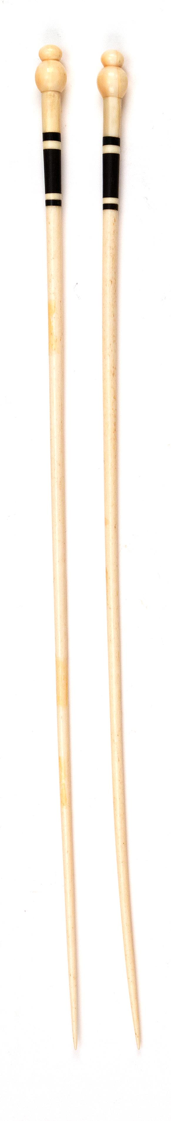 """PAIR OF WHALEBONE AND WHALE IVORY KNITTING NEEDLES Turned ball finials. Ebony banding below finials. Lengths 14.25"""". From the Howlan..."""