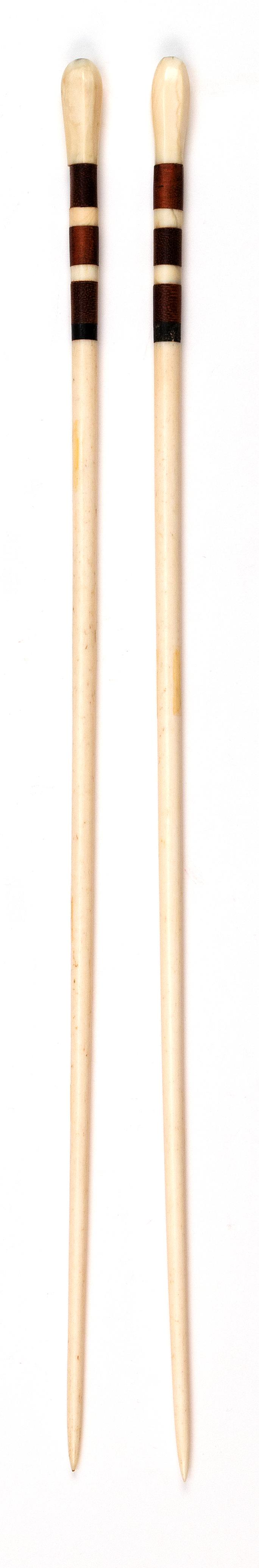 PAIR OF WHALEBONE AND WHALE IVORY KNITTING NEEDLES Hexagonal finials. Exotic wood and whale ivory banding below finials. Lengths 15....