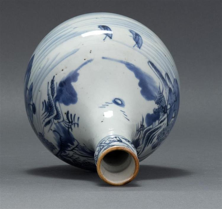CANTON PORCELAIN BOTTLE VASE With blue and white decoration and gilt mouth. Molded neck. Height 9