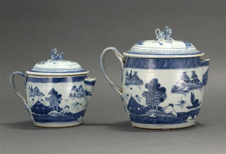 "TWO CANTON PORCELAIN COVERED CIDER PITCHERS Both with strap handles and foo dog finials. Blue and white decoration. Heights 7"" and 9..."