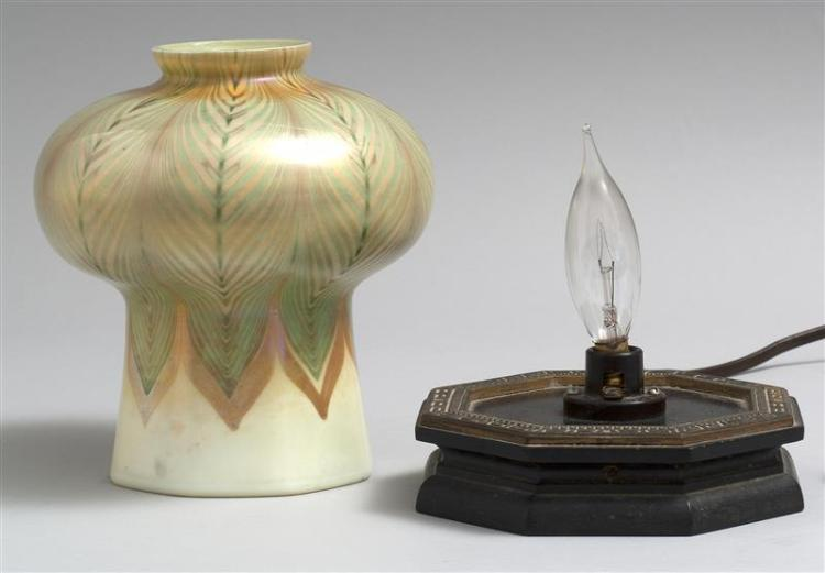 TIFFANY STUDIOS FAVRILE GLASS MOSQUE LAMP In a green and gold iridescent pulled feather design on a cream-colored ground. Shade with...