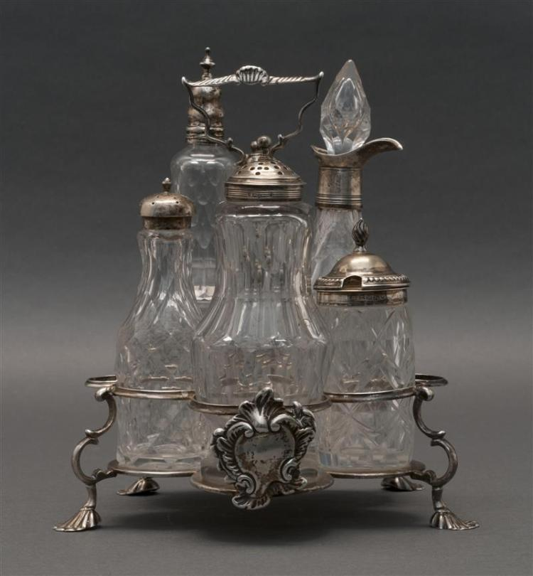 ASSEMBLED ENGLISH STERLING SILVER AND CUT GLASS CRUET SET The stand London, 1762, Robert Peaston, maker. Stand with vacant rococo sh...