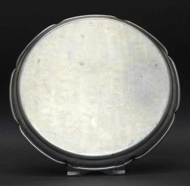 CARTIER STERLING SILVER TRAY Pinched rim resembles flower petals. Monogrammed