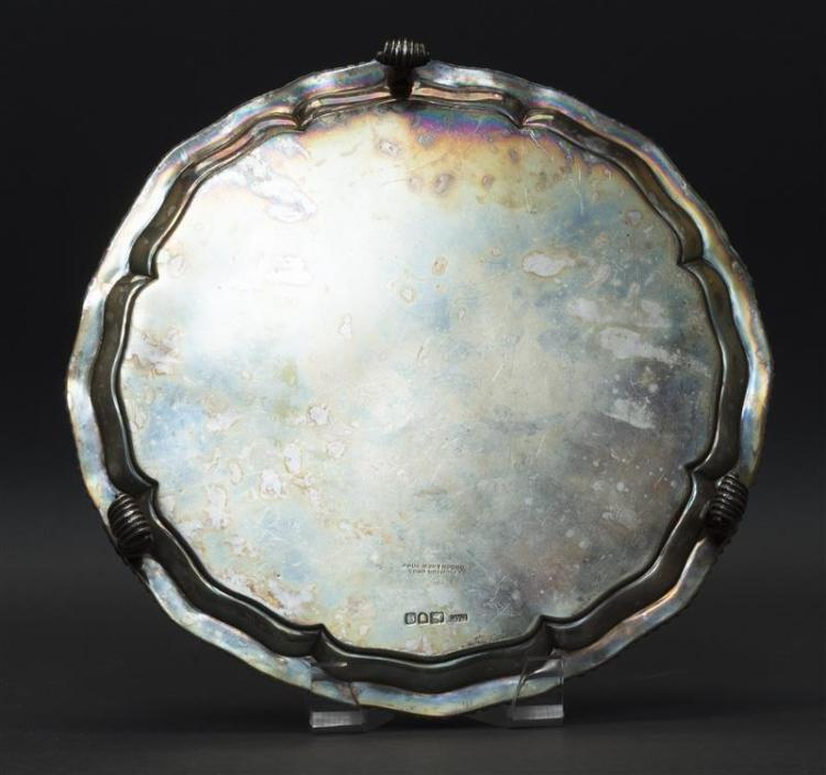 GEORGE V STERLING SILVER SALVER Crichton Brothers (Lionel Alfred Crichton), maker. In a Georgian style with shaped and molded edge,...