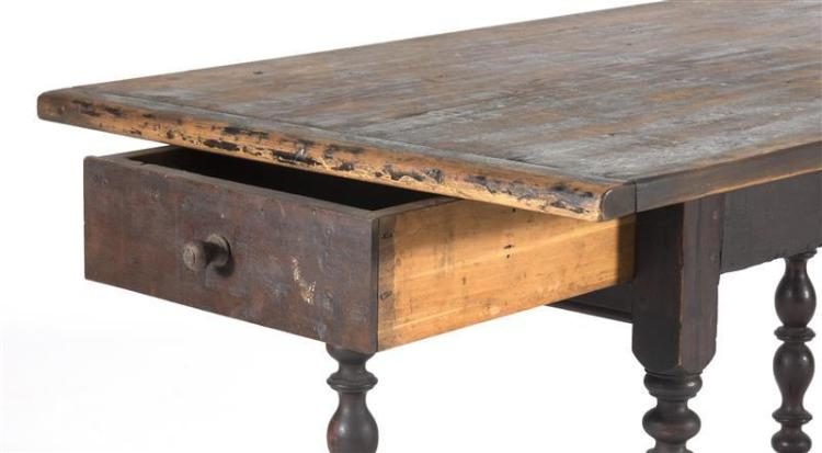 ANTIQUE AMERICAN ONE-DRAWER TAVERN TABLE In pine under a brown finish. Top with breadboard ends. Base with exceptionally turned legs...