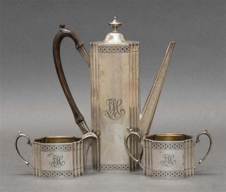 GORHAM THREE-PIECE STERLING SILVER TÊTE-A-TÊTE TEA SERVICE Includes a teapot, an open sugar bowl and a creamer, each with recessed c...