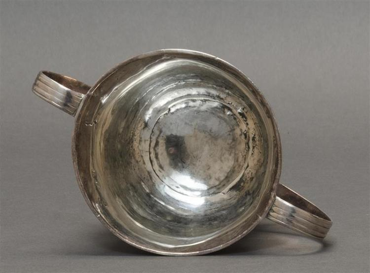 GEORGE II STERLING SILVER TWO-HANDLED PORRINGER Maker''s mark rubbed, possibly for Richard Bayley. In tulip form with reeded S-form h..