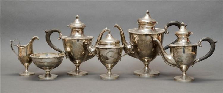 "AMERICAN STERLING SILVER TEA AND COFFEE SERVICE RETAILED BY SIMONS BROTHERS Includes a coffeepot, height 9.25"", a teapot, a chocolat..."