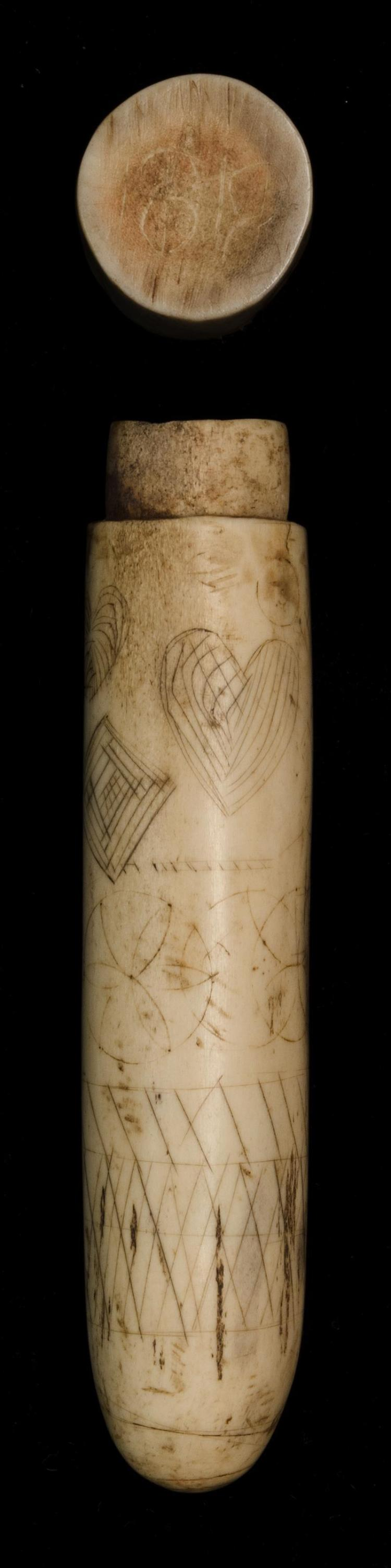 SCRIMSHAW CARVED WHALEBONE NEEDLE CASE Geometric designs surround circumference. Cover is of the period but not original to the piec...