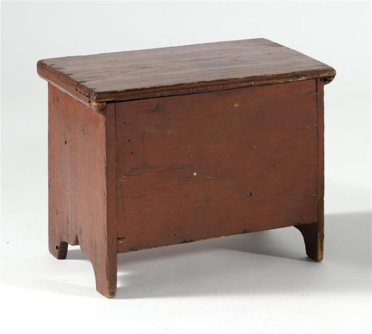 "MINIATURE LIFT-TOP CHEST In oak under red paint. Dated in red paint on back ""1838"". Lid attached with replacement iron hinges. Nicel..."