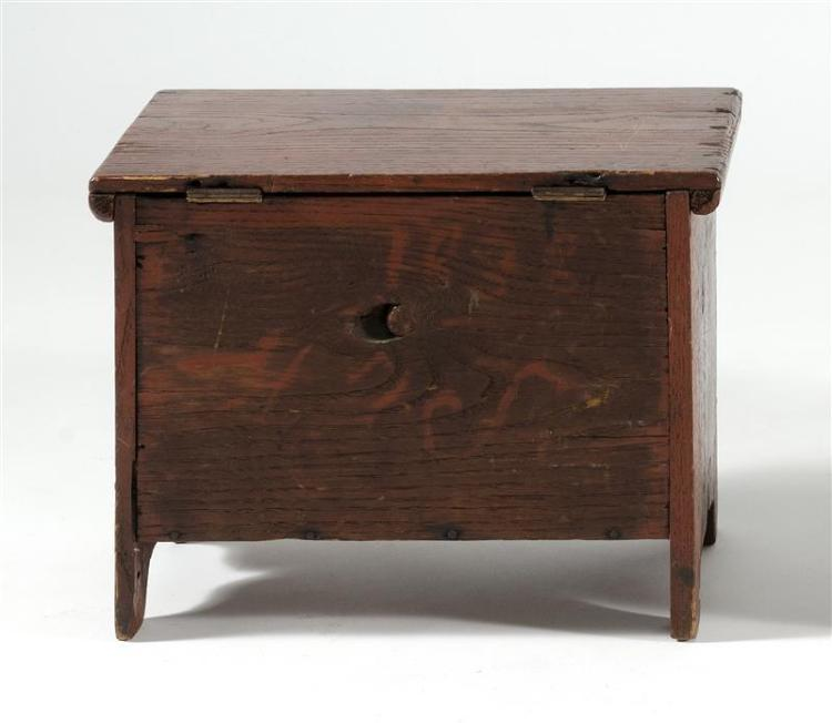 MINIATURE LIFT-TOP CHEST In oak under red paint. Dated in red paint on back