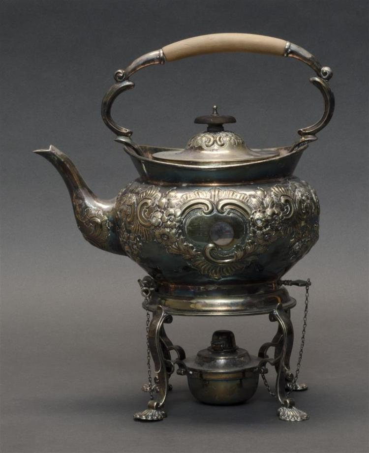 "SILVER PLATED KETTLE ON STAND In rococo style with shell-form feet. Overall height 12.5"". Ex Collection: George I. Purvis."