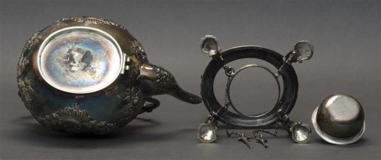 SILVER PLATED KETTLE ON STAND In rococo style with shell-form feet. Overall height 12.5