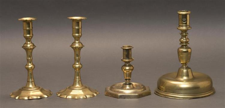 "FOUR BRASS CANDLESTICKS Includes a pair and two singles. Heights from 5.5"" to 8.75""."